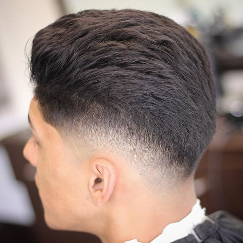 Brushed Back Hair with Low Drop Skin Fade