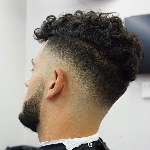 Curly Fringe Hair with Low Skin Drop Fade