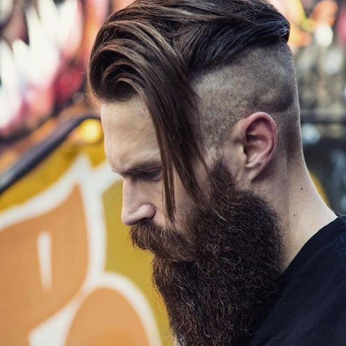 Disconnected Undercut with Long Side Swept Hair and Thick Beard
