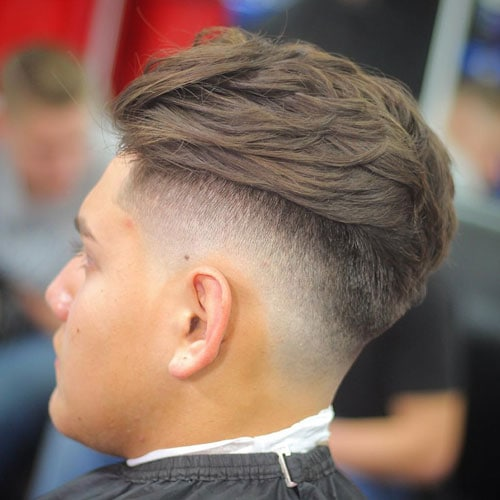 High Bald Drop Fade with Long Textured Brush Back