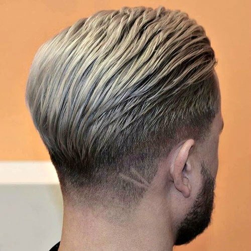 Low Taper with Textured Slicked Back Hair