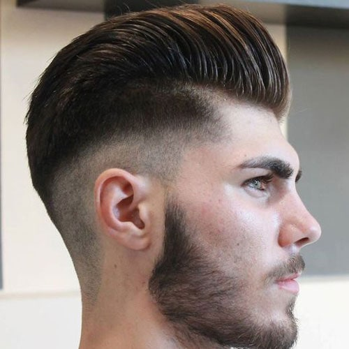 Modern Pompadour Hairstyle with Low Skin Fade and Beard