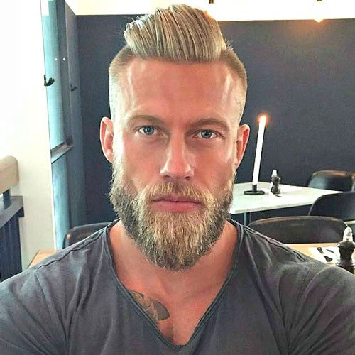 Slicked Back Hair with Undercut and Thick Beard