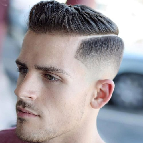 Tapered Sides with Hard Part and Brushed Up Hair