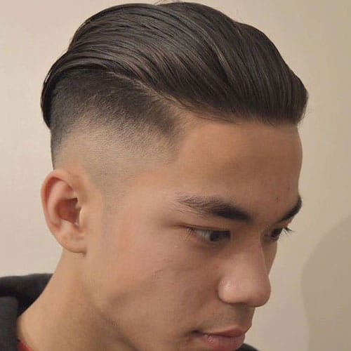 High Skin Taper Fade with Slicked Back Hairstyle
