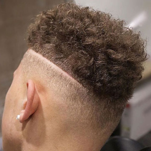 Hardline Part on Side - High Bald Fade with Curly Hair and Part