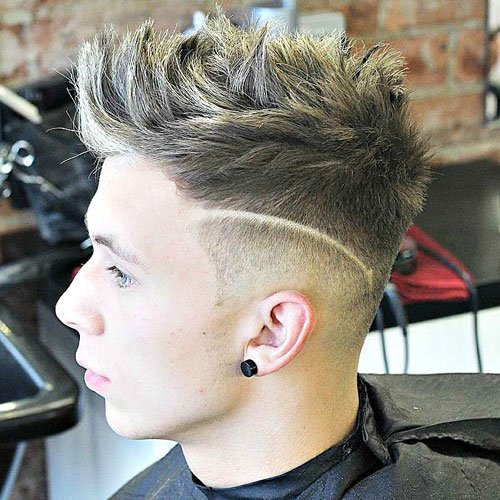 Brushed Up Hair with Low Taper Fade and Design