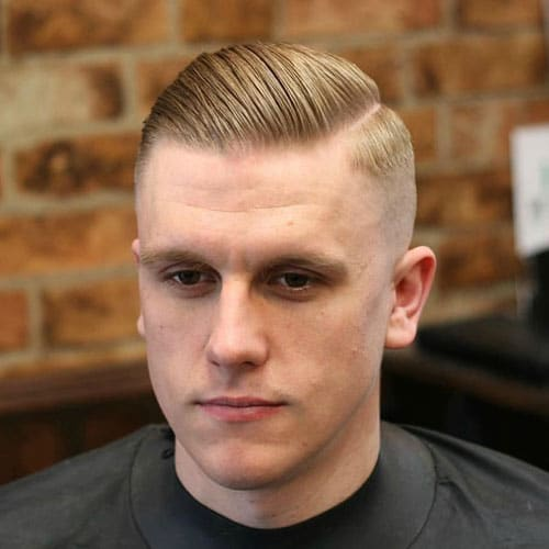High Skin Fade with Hard Part and Slick Back