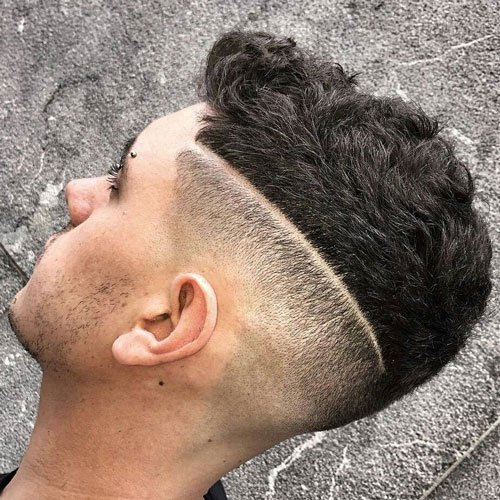 High Skin Fade with Tramline and Wavy Thick Hair