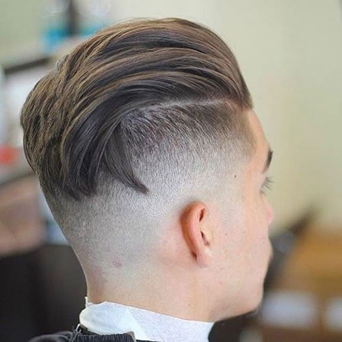 High Undercut Fade with Textured Slicked Back Hair