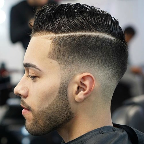 Low Fade with Hard Part and Comb Over