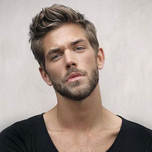 Medium Length Textured Hair with Tapered Sides and Full Beard