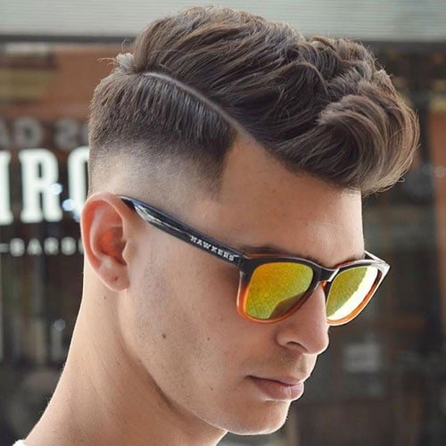 Mid Fade with Part and Wavy Textured Hair