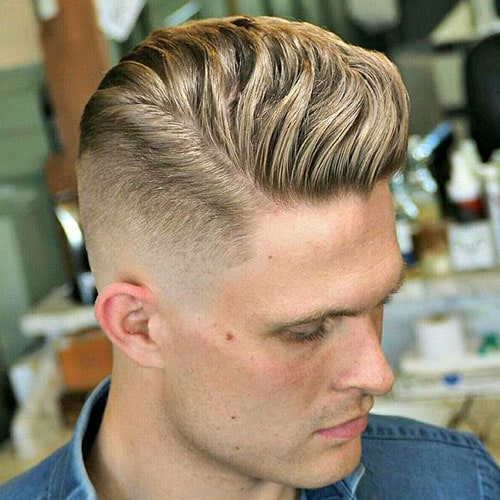 Mid Skin Fade with Wavy Brushed Up Hair