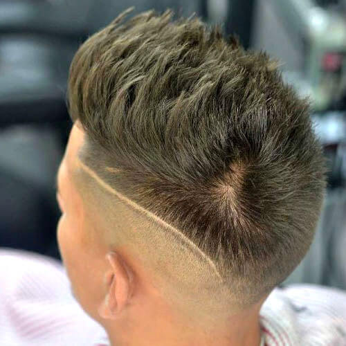 High Bald Fade with Spiky Hair and Design
