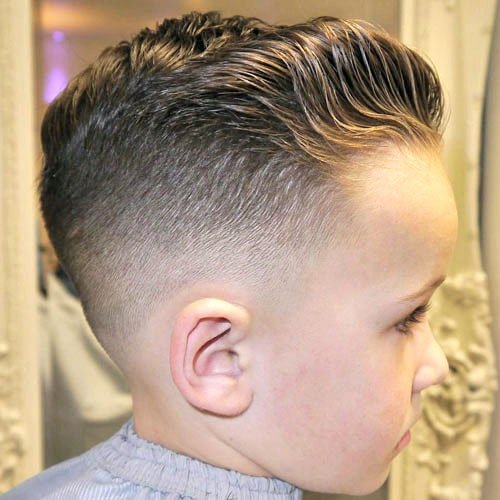 Low Bald Fade with Wavy Brushed Back Hair