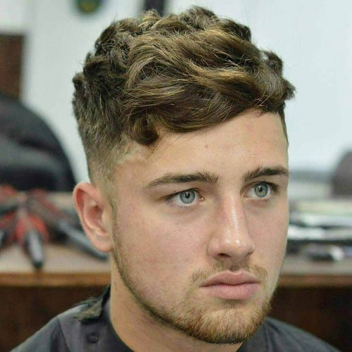 Low Fade with Textured Wavy Hair and Stubble