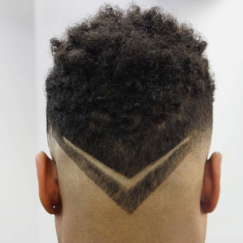 Low Skin Fade with Curls and V-Shaped Neckline