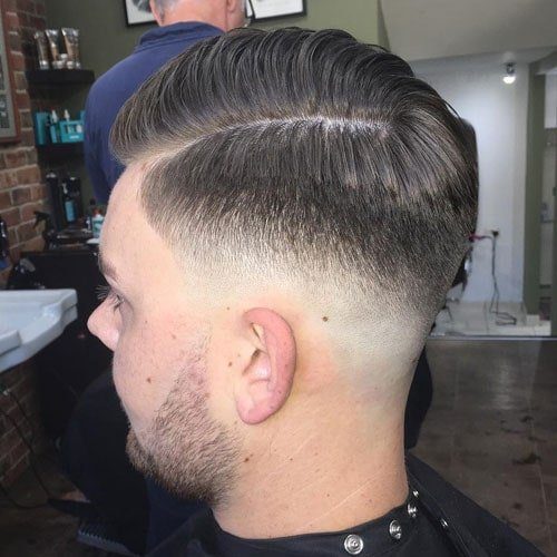 Mid Bald Fade with Hard Part Comb Over