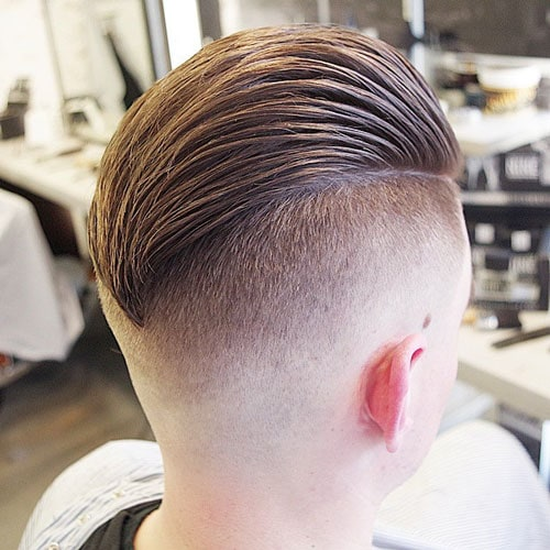 Slicked Back Hair with Disconnected Undercut