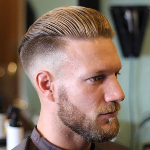 Undercut Fade with Slicked Back Hair and Beard