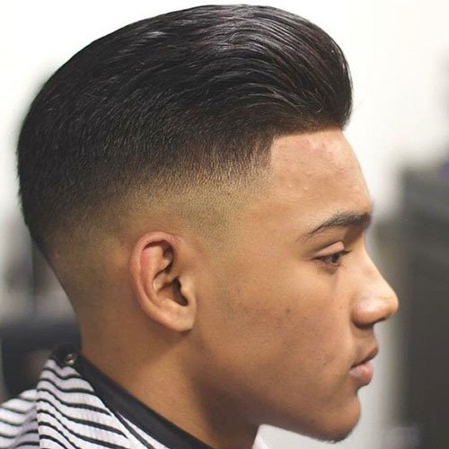 Brushed Back Hair with Mid Skin Fade