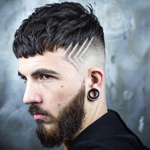 Simple haircut designs, such as these cool lines cut into a fade, can be stylish yet understated.