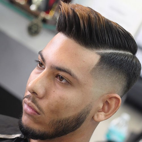 High Skin Fade with Spiky Comb Over and Part