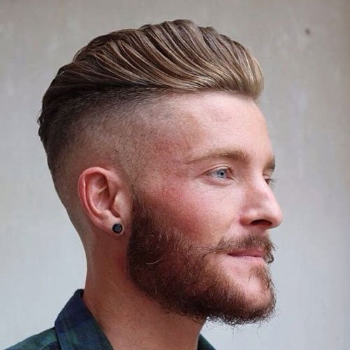 Wavy Brushed Up Hair and High Razor Fade