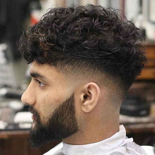 High Skin Fade + Layered Curly Top
