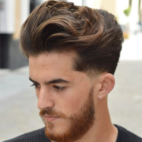 Long Brushed Back Hair + Low Fade