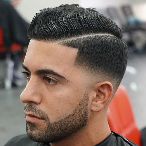 Wavy Comb Over + Hard Part + Low Bald Fade + Beard