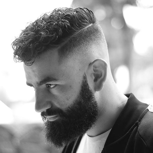 Curly Top + Skin Fade + Part + Full Beard