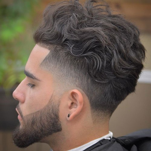 Long Wavy Brushed Back Hair + Low Fade