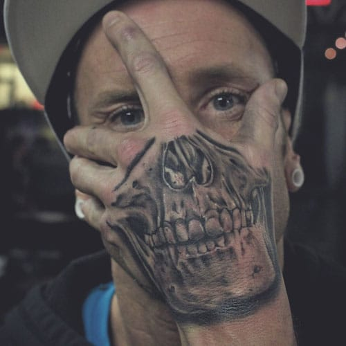 Face Bones Hand Tattoo
