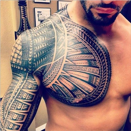 Cool Tribal Chest and Arm Tattoo