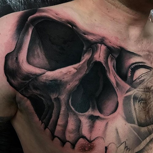 Scary Skull Chest Tattoo Designs For Guys
