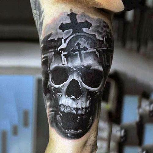 Skull Inner Bicep Tattoo
