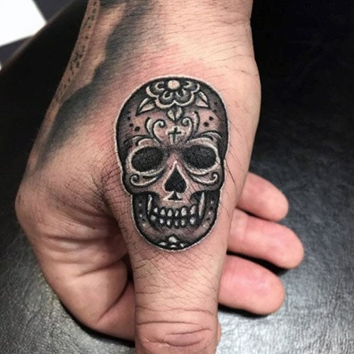 Small Skull Finger Tattoo