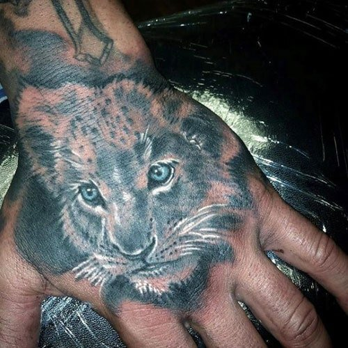 Lion Cub Hand Tattoo