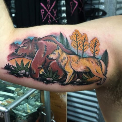 Bear and Wolf Bicep Tattoo