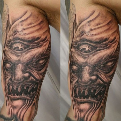Scary Monster Inside Bicep Tattoo Ideas