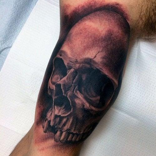 Skull Inner Bicep Tattoos