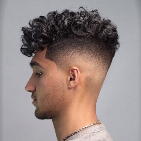 Curly Hair on Top with Fade Haircut on the Sides