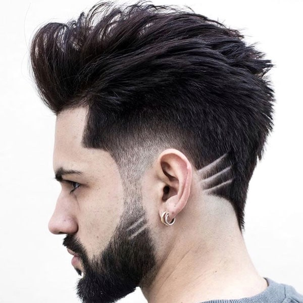 Edgy Blowout Taper Fade Hairstyle For Guys
